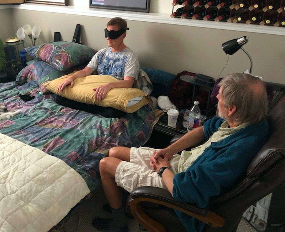 Thomas Hartle, left, takes part in a psychedelic-assisted psychotherapy session with Bruce Tobin, a clinical psychologist and therapist and founder of TheraPsil.